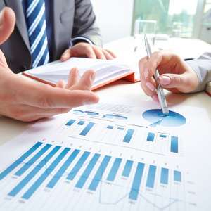 data review meeting with notes, charts and graphs