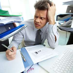 accountant overwhelmed by files and reports