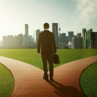 businessman facing a choice of two paths to take