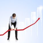 man trying to raise arrow against rising chart