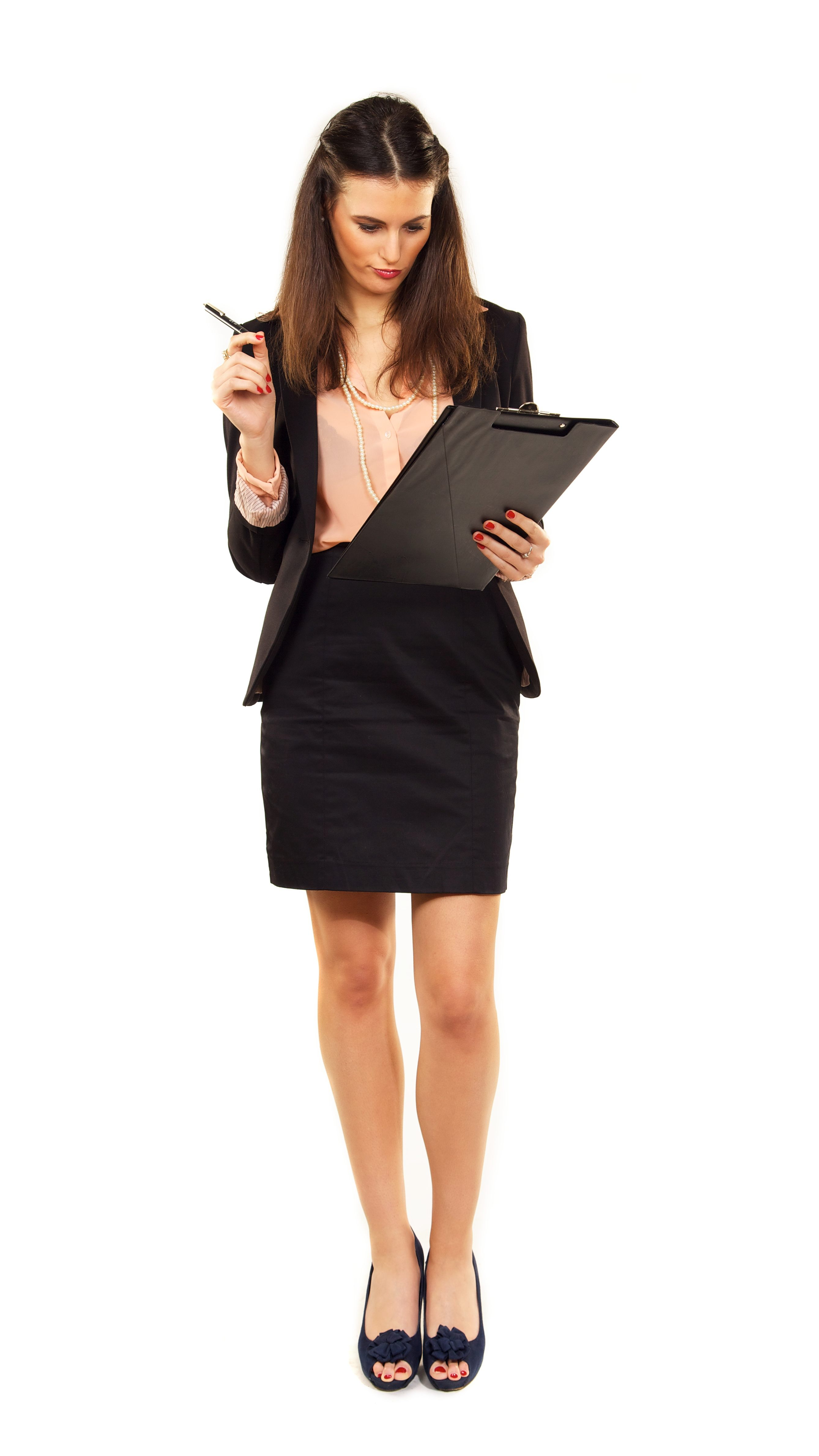 professional woman checking off her checklist on a clipboard with pen in hand