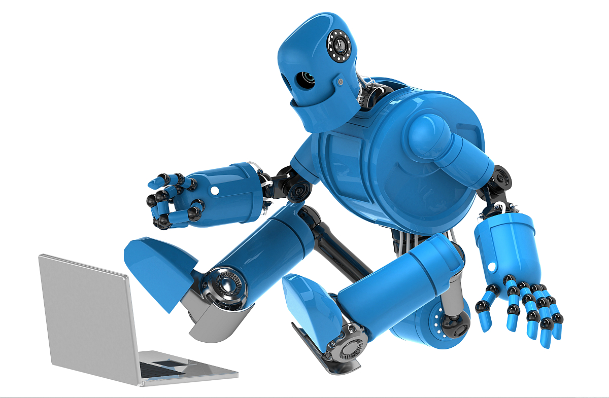 blue robot sitting in isolation with laptop computer