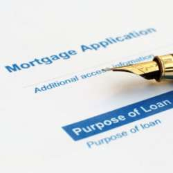 fountain pen lying on mortgage application